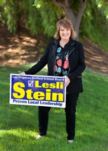 Lesli with lawn sign